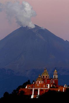 A plume of a    Popocatepetl volcano overshadowing the Catholic church Nuestra Señora de los Remedios in Cholula, in the Mexican state of Puebla.     (Marco Ugarte, Associated Press)