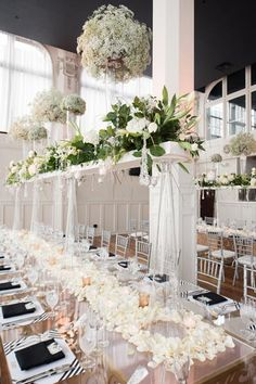 Baby's breath and white flower petals compliment each other perfectly on this multi-layered centerpiece.