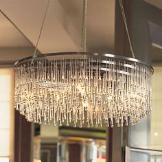 Glass Chandelier | light drizzle chandelier for living room | #chandelier #lightingdesign #luxuryhomes| For more inspirations: http://luxxu.net/