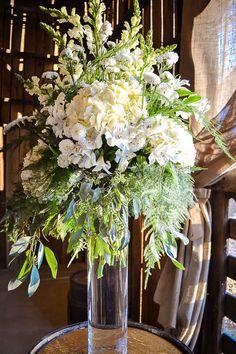 Wedding reception barn, wedding décor, fall wedding, wedding reception, wedding centerpiece, wedding flowers. Rustic barn wedding and reception venue in Alabama whiteacresfarms.com
