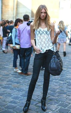 Romee Strijd street style white lace shirt and black skinny jeans