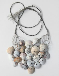 Necklace   Design Squish. Seashells found on the shores of Florida Sanabel beach. Holes in seashells are naturally carved by predatory snail called a Moon Snail.  Natural fiber