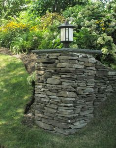 landscaping lights for stone walls   dry field stone column with light i n dry stone masonry correct ...