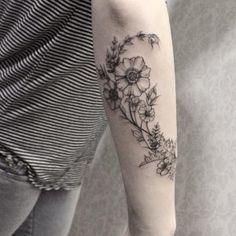 Beautiful floral forearm work by Sandra Cunha