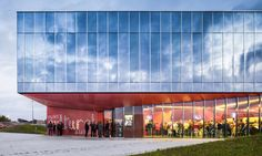 The reflective exterior of La Hague Cultural Center in France hides a playful red interior | Inhabitat - Green Design, Innovation, Architecture, Green Building