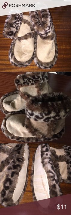 Boot is fuzzy slippers These slippers are as good as new.  They are soft and comfortable Shoes Slippers