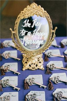 vintage wedding escort card ideas with keys and mirror