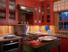 So, having red kitchen accents or red kitchen walls isn't all that uncommon. Wood Kitchen, Wood Kitchen Cabinets, Rustic Kitchen, Red Kitchen Cabinets, Kitchen Design, Red Kitchen, Painted Kitchen Cabinets Colors, Cabin Kitchens, Kitchen Cabinets