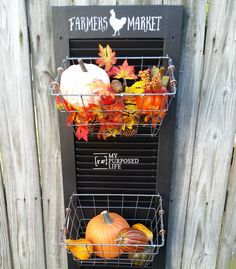 How to repurpose an old shutter into a hanging produce bin by adding some hooks and wire baskets. Lean against the wall or hang it to keep produce handy.