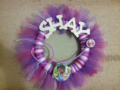 """doc mcstuffins wreath I made this but only the tulle part and hung """"The Doc Is In"""" sign in the middle"""