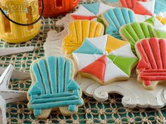 Summer Cookies by Semi Sweet Designs @SemiSweetMike. A step-by-step tutorial on how to create beach umbrella and chair cookies. Free printable template for decorating too!