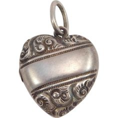 This is a beautiful ornate sterling silver repousse and engraved puffy heart locket pendant or charm. It is marked sterling and opens to reveal Locket Charms, Heart Locket, Victorian Jewelry, Vintage Jewelry, Silver Lockets, Pendant Jewelry, Fine Jewelry, Pendants, Charmed