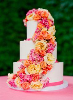Summer wedding cake idea - three-tiered wedding cake with bright pink, yellow + orange flowers {Lisa Lefkowitz Photography}