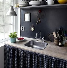 another interesting skirted sink....great design impact!