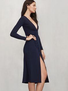 Cyan Dress, a long sleeve, midi length wrap dress with a deep V neckline and adjustable tie at the waist.