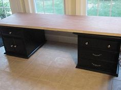 How to make a sewing table from side tables and cheep door from Lowes...LOVE