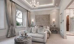 high deep buttoned (tufted) silk headboard - glamorous master bedroom in shimmering champagne neutrals by Emma Lovenberry . Hampton Surrey