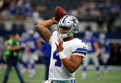 Dallas Cowboys quarterback Dak Prescott (4) throws a pass as he warms up before an NFL football game against the New York Giants on Sunday Sept. 11, 2016, in Arlington, Texas.