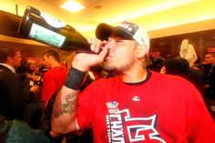 Yadier Molina celebrates in the clubhouse..NLCS champions  10-18-13