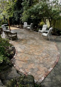 Paleo paver patio with recycled Seattle street brick edge - West Seattle, Ecoyards