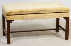 Lot 650: Upholstered Mahogany Bench by Kittenger; Having wooden legs and stretcher with upholstered top and cushion
