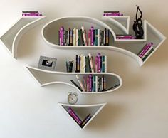 22 Creative Bookshelves Guaranteed to Give You Shelf Envy Who doesn't love superman decor? These creative floating bookshelves are definitely super. Creative Bookshelves, Floating Bookshelves, Bookshelf Ideas, Bookshelf Design, Wall Shelves, Shelving, Book Shelves, White Shelves, Deco Originale