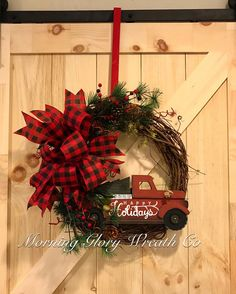 A personal favorite from my Etsy shop https://www.etsy.com/listing/564827223/red-truck-farmhouse-wreath-for-your-front-door #rustic #farmhousedecor #wreathideas #redtruckwreath #christmasdecor #morningglorywreathco #buffaloplaid