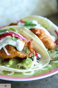 Fried Avocado Tacos! -black beans, salsa verde,  Monterey jack cheese, líme cílantro creme and sweet and spícy red oníons...