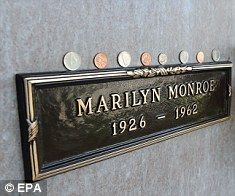 2009- An American widow is auctioning off the burial plot above Marilyn Monroe's in an effort to pay off her mortgage. Elsie Poncher's late husband Richard currently resides in the crypt above the star in Westwood Village Memorial Park Cemetary, Los Angeles. But Mrs Poncher is prepared to move her husband's remains – if the price is right.