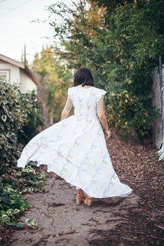 Erin of @calivintage wearing Legends Palm Dress