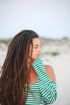Pretty picture, her dreads are the type i'd like to do.. Not too thick not too thin just perfect.