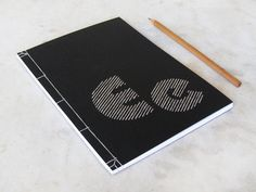 E. Minimalistic Embroidered Letter Notebook by FabulousCatPapers
