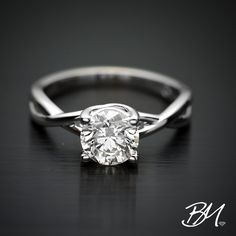 Gorgeous 1 carat round brilliant diamond engagement ring in a classic criss-cross setting. We can take care of all of your custom bridal jewelry needs! #diamonds #diamondengagementring #wedding #customjewelry #customengagementring #bridal #bridalfashion #oneofakindjewelrydesign #jewelry #bride #weddingjewelry