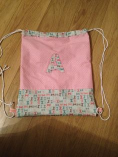 Drawstring bag with applique