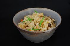 rice seasoned and cooked with various ingredients in rice bowl by Bizen pottery. 炊き込みご飯(備前焼)