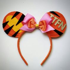 Check out this item in my Etsy shop https://www.etsy.com/listing/214077141/custom-tigger-mouse-ears