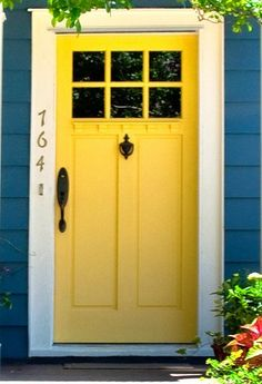 Yellow front door with blue exterior paint