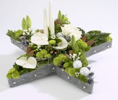 Christmas Advent Star arrangement an alternitive to a Advent Wreath. Contains Lilies, Feeling Green, Baubles and lots of other interesting details. Christmas Door Wreaths, Holiday Wreaths, Christmas Crafts, Christmas Decorations, Christmas Ornaments, Advent Wreaths, Reindeer Christmas, Christmas Star, Christmas Trees