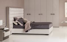 """A headboard in satin, trimmer in leather with a luxurious quilted finish… [Letto matrimoniale / Double Bed """"Sanya"""" by Carlo Colombo for #Flou] #Beds #Bedroom #Letto #InteriorDesign #HomeDecor #Design #Arredamento #Furnishings #White #Letti #Beds #TotalWhite #GreyandWhite"""