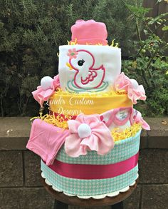 Adorable baby girl little duckie diaper cake is stocked with new goodies for the new or expecting mommy and baby! Our diaper cake features 4 tiers and is loaded with burp cloths baby socks baby wash Baby Shower Items, Baby Shower Diapers, Baby Shower Cakes, Baby Shower Gifts, Shower Baby, Baby Showers, Baby Girl Caps, Baby Girl Newborn, Pamper Cake