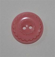 """Vintage Colt button - pattern is yet to be numbered - pink color in excellent condition - measures 3/4"""" at center - single injection mold mark. Price $ 7.00"""