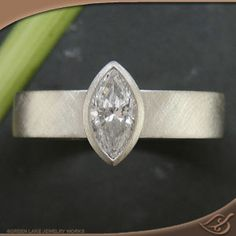 My Custom Jewelry Design at Green Lake Jewelry Works Custom Full bezel marquise diamond setting with matte criss cross finish background Marquise Diamond Settings, Marquise Ring, Custom Jewelry Design, Custom Design, Green Lake Jewelry, Design Your Own Ring, Antique Engagement Rings, Ring Settings, Bling