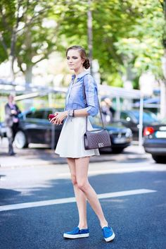 Find Out Which Designer Bags Are Most Popular in Your City via @WhoWhatWear // white mini skirt and blue oxford shirt.