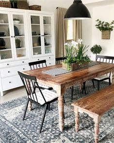 lovely dining blue and white dining room rug, brown traditional wood table with bench and black chairs, white hutch Dining Room Inspiration, Home Decor Inspiration, Dining Table With Bench, Wood Table, Dining Tables, White Dining Room Table, Black Dining Bench, Black And White Dining Room, Dining Room Bench Seating