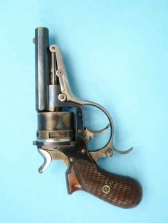 Fine Galand Double Action Self-Extracting Pocket Revolver Serial no. 14461, 7.65mm caliber centerfire, 3-inch octagonal barrel, blued, with case-hardened non-fluted six-shot cylinder; lever, trigger and hammer bright steel; checkered and varnished walnut grips. Crown over C.F.G. proofmarking on left side of barrel breech; proofmark on right side of frame. Condition: Fine to excellent. 95% blue and case-hardening; grips fine.