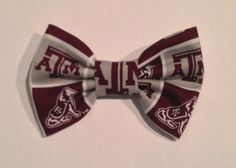 A beautiful Texas A University handmade fabric hair bow that will be perfect for football season. The bow measures 4 inches by 3 inches and has a barrette clip on the back.
