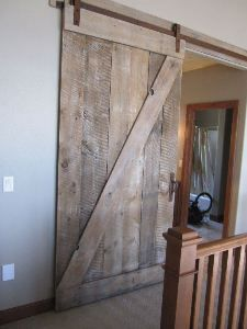 Door: Use a barn door to cut down on space? Rusty patina, a good match for the weathered barn door wood. Think lake house or cabin in the woods. Sliding Door Hardware, Sliding Doors, Track Door, Home Goods Decor, Home Decor, Interior Barn Doors, Basement Remodeling, Wood Doors, Decoration
