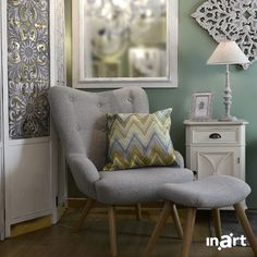 Classy and comfy is the perfect combination for your reading corner! Sink into a lovely large chair, prop your feet up on a footrest and let the elegant decorations take you back in time. Decor, Interior Design, Grey Armchair, Furniture, Corner Chair, Home, Elegant Decor, Home Decor, Large Chair
