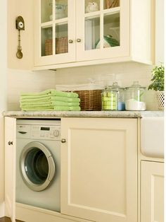 Laundry Behind Cabinet Drawers in the kitchen.... Love that it would be in the house but also hidden...
