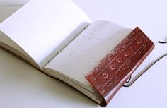 hand made, acid free, recycled paper journal.